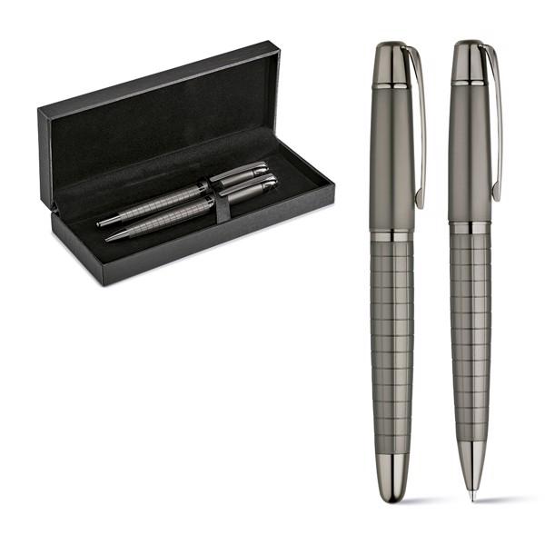WARHOL. Roller pen and ball pen set in metal